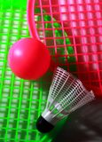 Colorful chidren toy racket with two balls. Green and pink toy rackets and two plastic balls close up  photo with side lighting effect Stock Photos