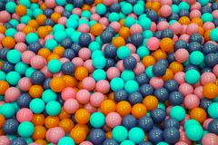 Colorful child balls. Multi-colored plastic balls. A children`s playroom. Background texture of multi-colored plastic balls on th stock image