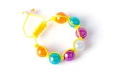 Colorful child bracelet isolated on white background Stock Photo