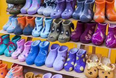 Colorful child felt boots for sale. Colorful child felt boots displayed in marketplace Stock Photography