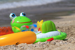 Colorful child's beach toys Stock Photos