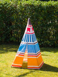 Colorful child`s toy Teepee tent on the grass royalty free stock photo
