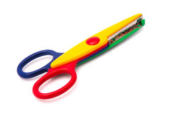 Colorful childhood scissors Royalty Free Stock Images