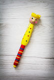 Colorful childish funny pen on the wooden texture Stock Images