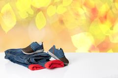 Colorful children jeans clothes. Fashionable red lined thermoje royalty free stock images