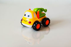 Colorful, children plastic toy, toy truck tractor with a smile a royalty free stock images
