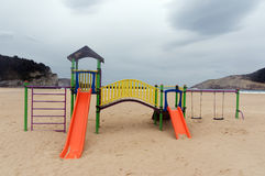 Colorful children playground on beach Stock Photos