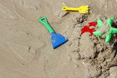 Colorful Children's beach toys on sand. Colorful Children's beach toys play on sand Stock Photography
