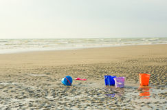 Colorful children's buckets for playing on beach Stock Photos