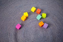 Colorful children`s building blocks on gray background stock images