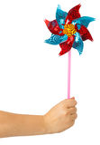 Colorful children's pinwheel in female hand Royalty Free Stock Photo