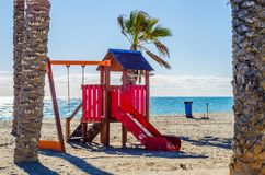 Colorful children`s Playground on the beach on a hot day, Playgr. Ound for children near the sea, relax and fun Stock Image