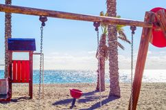 Colorful children`s Playground on the beach on a hot day, Playgr. Ound for children near the sea, relax and fun Royalty Free Stock Image