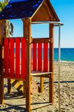 Colorful children`s Playground on the beach on a hot day, Playgr. Ound for children near the sea, relax and fun Royalty Free Stock Images
