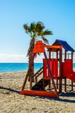 Colorful children`s Playground on the beach on a hot day, Playgr. Ound for children near the sea, relax and fun Royalty Free Stock Photography