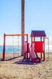 Colorful children`s Playground on the beach on a hot day, Playgr. Ound for children near the sea, relax and fun Stock Photo
