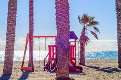 Colorful children`s Playground on the beach on a hot day, Playgr. Ound for children near the sea, relax and fun Stock Photos
