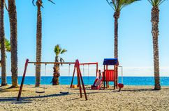 Colorful children`s Playground on the beach on a hot day, Playgr. Ound for children near the sea, relax and fun Stock Photography