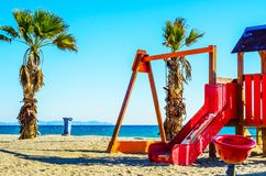 Colorful children`s Playground on the beach on a hot day, Playgr. Ound for children near the sea, relax and fun Royalty Free Stock Photo