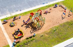 Colorful children`s playground for kids in new residential area. Veliky Novgorod, Russia - August 17, 2017: Colorful children`s playground for kids in new Royalty Free Stock Photo
