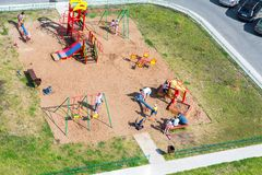 Colorful children`s playground for kids in new residential area. Veliky Novgorod, Russia - August 17, 2017: Colorful children`s playground for kids in new Stock Photo