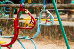 Colorful children swing in playground.Toys for children.  Stock Photos