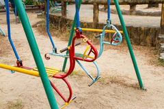 Colorful children swing in playground.Toys for children.  Royalty Free Stock Photo