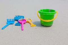 Colorful Children's beach toys on sand Stock Image