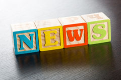 Colorful Childrens Blocks Spelling the Word News Stock Photos