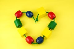 Colorful Childs Wooden Beads Heart Shape Royalty Free Stock Photos