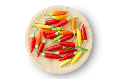 Colorful chili peppers plate isolated Stock Photo