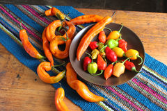 Colorful Chili Peppers on Table with Place Mat Royalty Free Stock Image