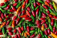 Colorful Chilli Peppers On Wooden Table. High Angle View Close Up royalty free stock photo