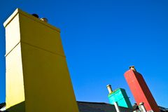 Colorful chimneys Stock Images