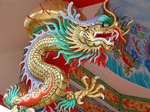 Colorful China dragon on oriental temple roof royalty free stock images