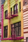 Colorful Chinatown Building,Fire Escapes. Downtown Chinatown colorfully painted building with fire escapes stock images