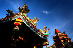 Colorful chinese buddhist temple with blue sky in Thailand Royalty Free Stock Image