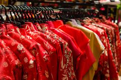 Colorful chinese cheongsam hanging for sale stock images