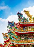 Colorful chinese dragon and swan sculpture on the rooftops of ch royalty free stock images