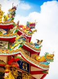 Colorful chinese dragon and swan sculpture on the rooftops of ch Royalty Free Stock Photo