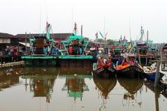 Colorful chinese fishing boat resting at a Chinese Fishing Village, Sekinchan, Malaysia Stock Photo
