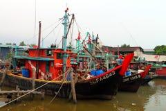 Colorful chinese fishing boat resting at a Chinese Fishing Village, Sekinchan, Malaysia Royalty Free Stock Photos