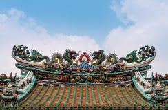 Colorful Chinese temple roof decoration ornament with dragon and. Sacred heaven animal sculptures, Wat Mangkon Kamalawat Leng Noei Yi BANGKOK, THAILAND stock photo