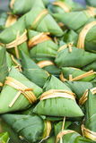 Colorful chinese zongzi. Colorful traditional chinese glutinous rice balls wrapped in bamboo leaves Stock Photography