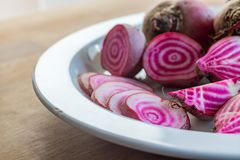 Chioggia beets on a plate. Colorful Chioggio beets cut in various ways in a white plate Royalty Free Stock Photos