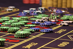 Colorful chips on the table in casino Royalty Free Stock Photo