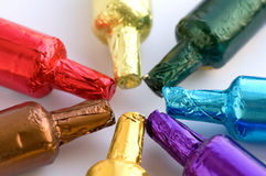 Colorful chocolate bottles Stock Photography