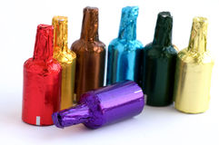Colorful chocolate bottles Stock Photos