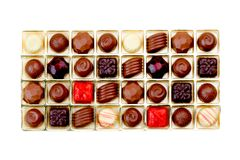 Colorful chocolates in box isolated on white  Royalty Free Stock Photos