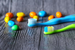 Colorful chocolate buttons and toothbrush Royalty Free Stock Image